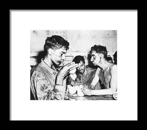 Young Men Framed Print featuring the photograph Marines Resting After Marshall Islands by Bettmann
