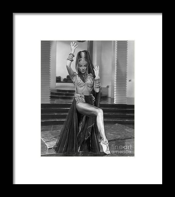 People Framed Print featuring the photograph Marlene Dietrich Dressed As Harem Queen by Bettmann