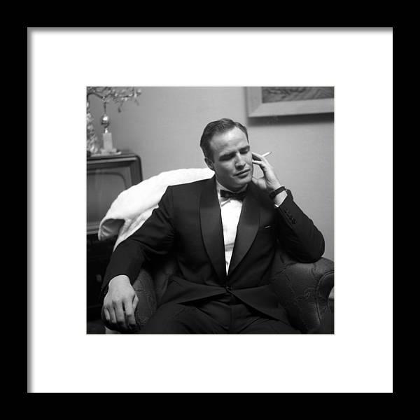Marlon Brando Framed Print featuring the photograph Marlon Brando At A Party by Michael Ochs Archives