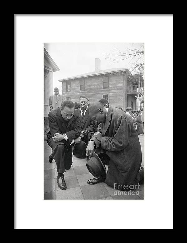 Mature Adult Framed Print featuring the photograph Martin Luther King Jr. Praying by Bettmann