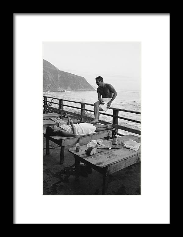 Steve Mcqueen Framed Print featuring the photograph Mcqueen & Adams Relax In Big Sur by John Dominis