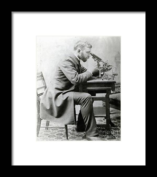 Young Men Framed Print featuring the photograph Medical Student At Microscope by Bettmann