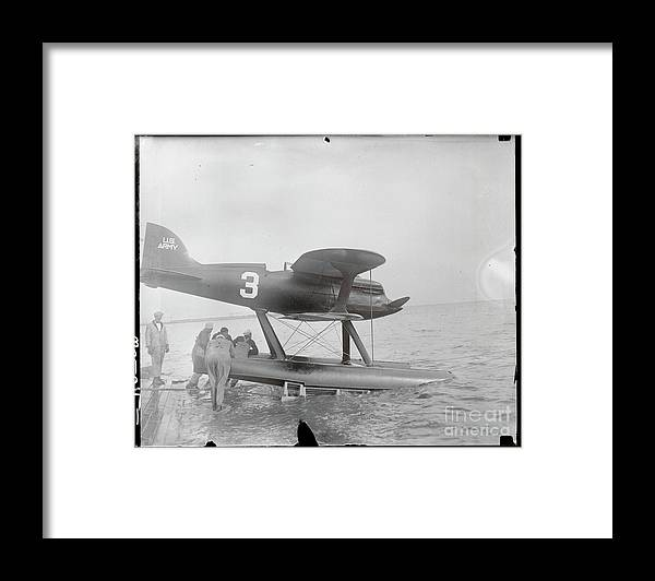 People Framed Print featuring the photograph Men Pushing Curtiss Racing Plane by Bettmann