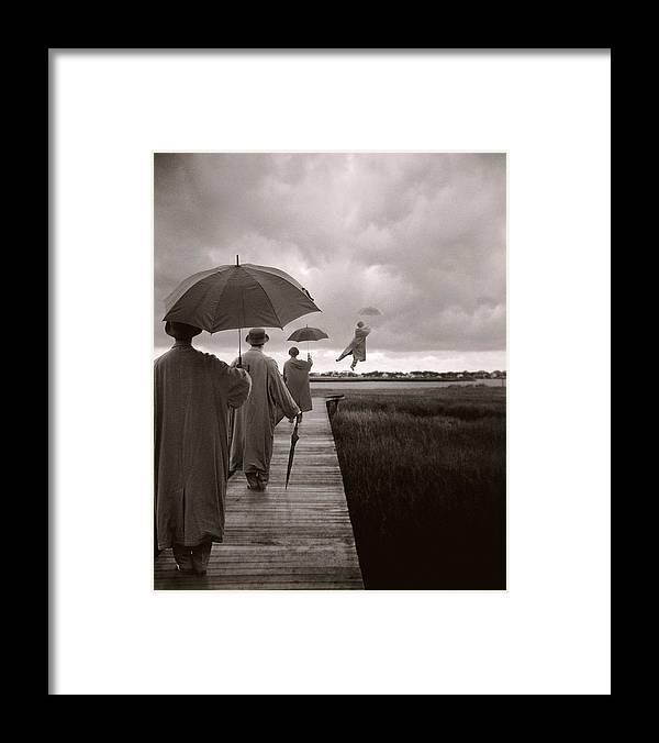 Corporate Business Framed Print featuring the photograph Men With Umbrellas Flying Into Sky by Bryce Lankard