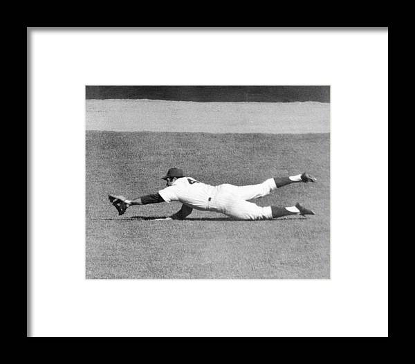 Ninth Inning Framed Print featuring the photograph Mets Ron Swoboda Dives To Stab Brooks by New York Daily News Archive
