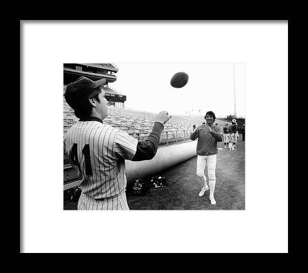 American League Baseball Framed Print featuring the photograph Mets Tom Seaver Warms Up Jets Joe by New York Daily News Archive
