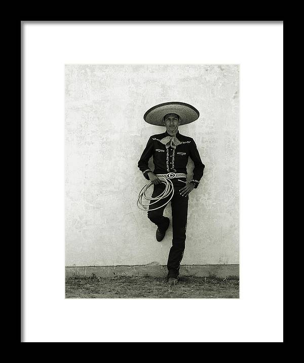 Cool Attitude Framed Print featuring the photograph Mexican Cowboy Wearing Hat And Holding by Terry Vine