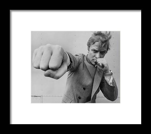 Michael Caine Framed Print featuring the photograph Michael Caine Throwing A Punch by Stephan C Archetti