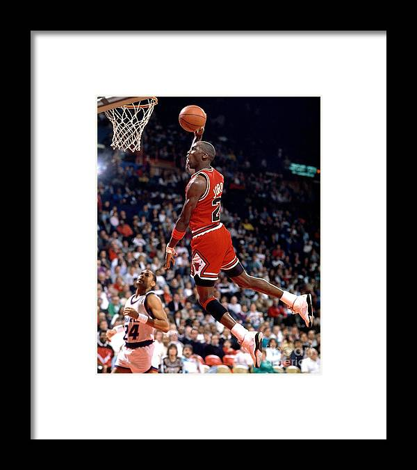 Chicago Bulls Framed Print featuring the photograph Michael Jordan Action Portrait by Jerry Wachter