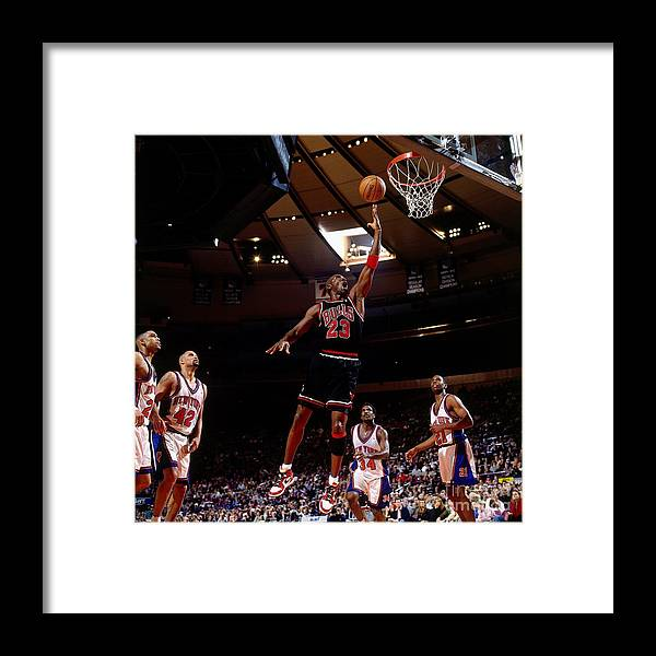 Chicago Bulls Framed Print featuring the photograph Michael Jordan Action Portrait by Nathaniel S. Butler