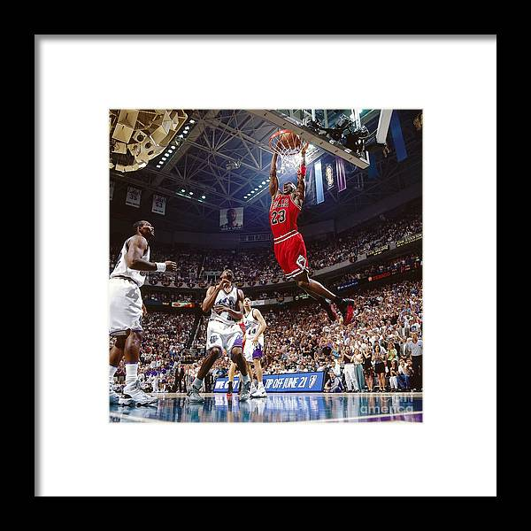 Chicago Bulls Framed Print featuring the photograph Michael Jordan Attempts A Dunk by Nathaniel S. Butler