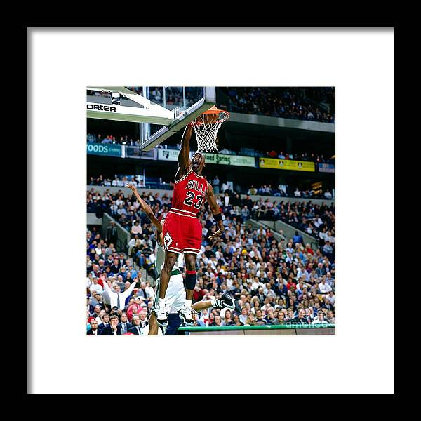 Chicago Bulls Framed Print featuring the photograph Michael Jordan Dunks The Ball by Nathaniel S. Butler