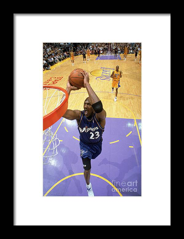 Nba Pro Basketball Framed Print featuring the photograph Michael Jordan Goes Up For The Dunk by Andrew D. Bernstein