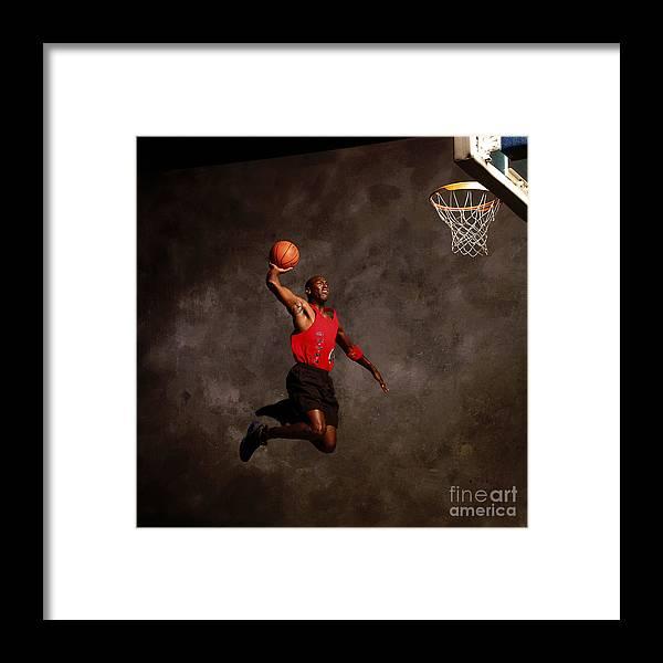 Chicago Bulls Framed Print featuring the photograph Michael Jordan Mock Action Portrait by Nba Photos