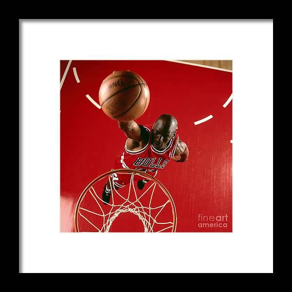 Chicago Bulls Framed Print featuring the photograph Michael Jordan Slam Dunk by Nba Photos