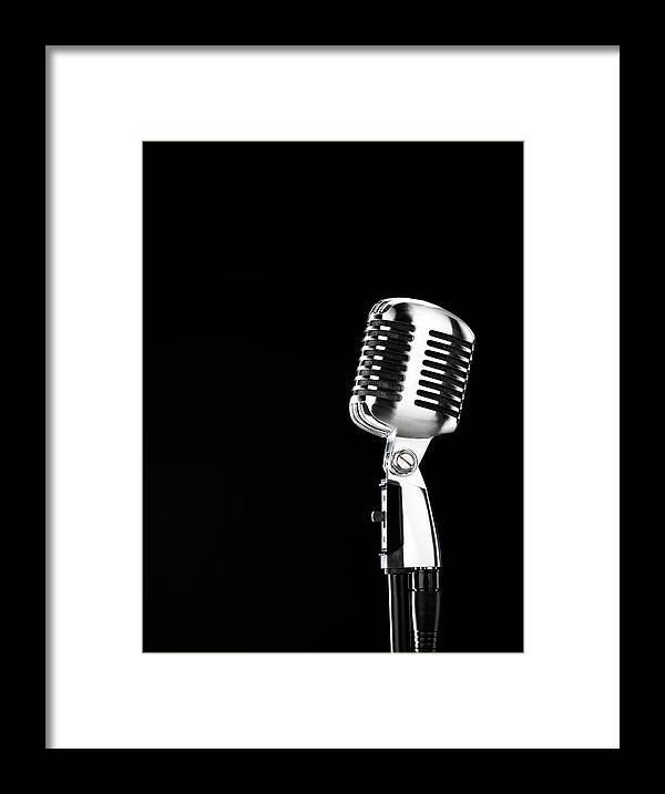 Music Framed Print featuring the photograph Microphone Against Black Background by Peter Dazeley