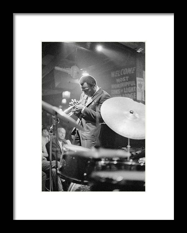 Concert Framed Print featuring the photograph Miles Davis Performing In Nightclub by Bettmann