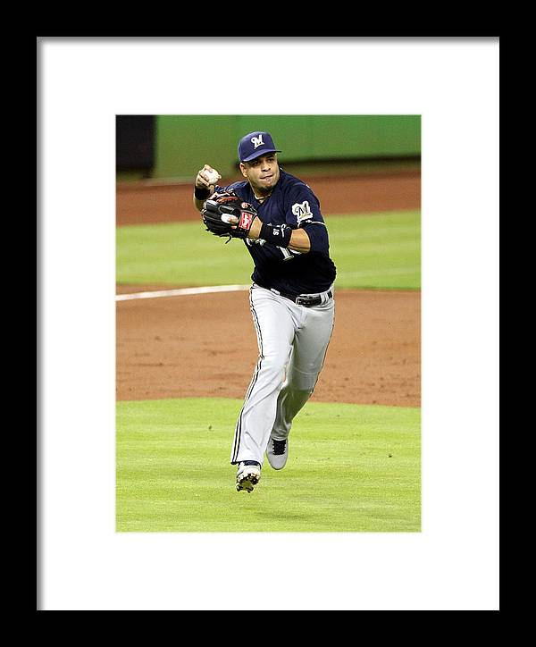 American League Baseball Framed Print featuring the photograph Milwaukee Brewers V Miami Marlins by Marc Serota