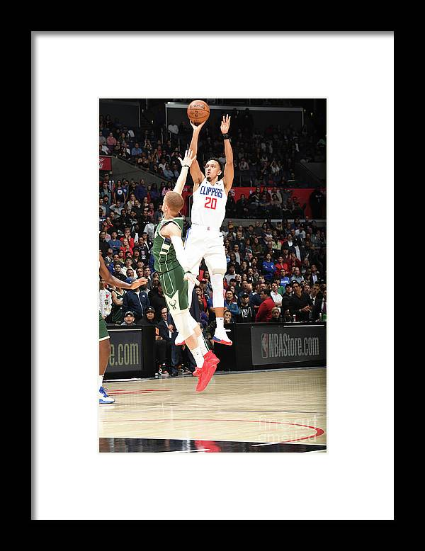 Nba Pro Basketball Framed Print featuring the photograph Milwaukee Bucks V La Clippers by Andrew D. Bernstein