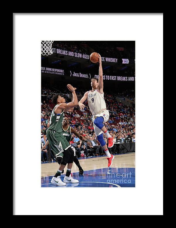 Sports Ball Framed Print featuring the photograph Milwaukee Bucks V Philadelphia 76ers by David Dow