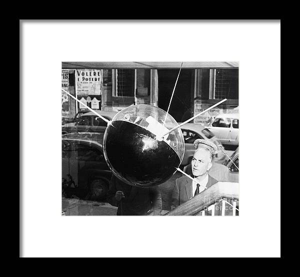 People Framed Print featuring the photograph Model Of Sputnik In Store Window by Bettmann