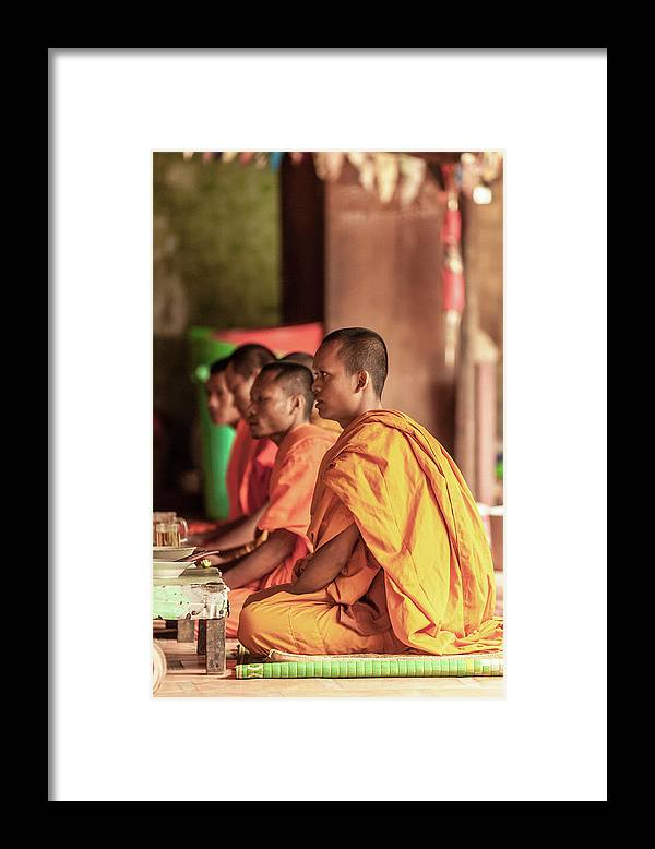 Young Men Framed Print featuring the photograph Monks At Breakfast, Wat Monastery by Cultura Rm Exclusive/gary Latham