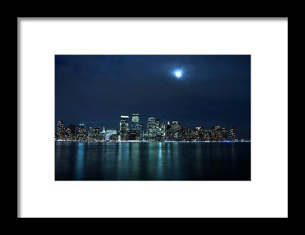 Lower Manhattan Framed Print featuring the photograph Moon Light Over New York City by Brandonj74