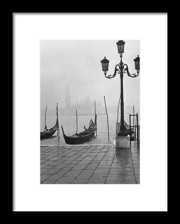 Timeincown Framed Print featuring the photograph Moored Gondolas On A Foggy Grand Canal W by Dmitri Kessel
