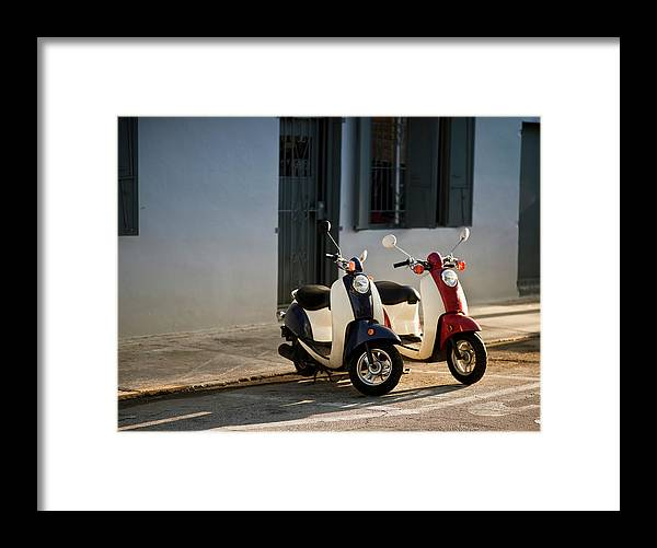 In A Row Framed Print featuring the photograph Motorbikes Parked On The Road by Pgiam