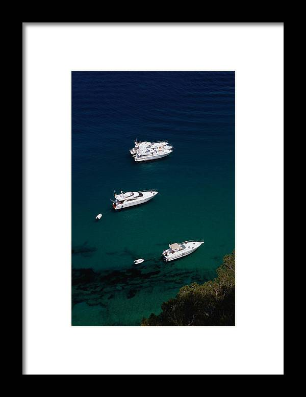 Catalonia Framed Print featuring the photograph Motorboats Anchored Off The Coast Of by Stephen Saks