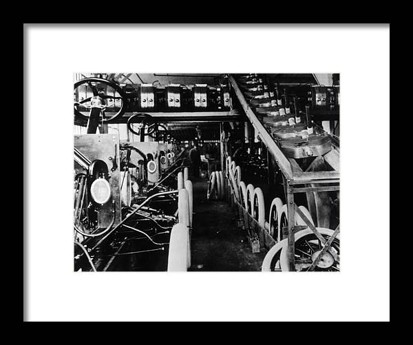 1910-1919 Framed Print featuring the photograph Moving Assembly Line by Hulton Archive