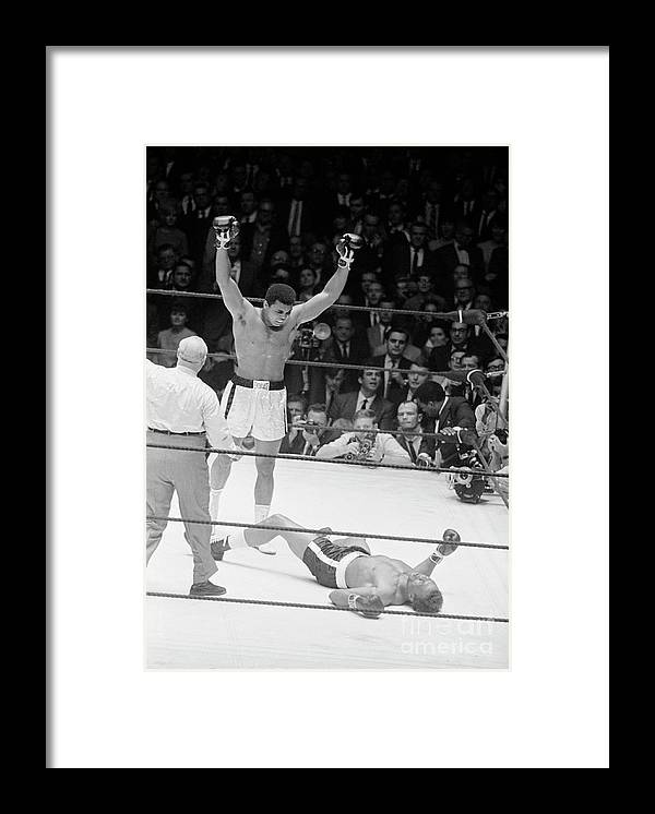 Human Arm Framed Print featuring the photograph Muhammad Ali Knocks Out Cleveland by Bettmann