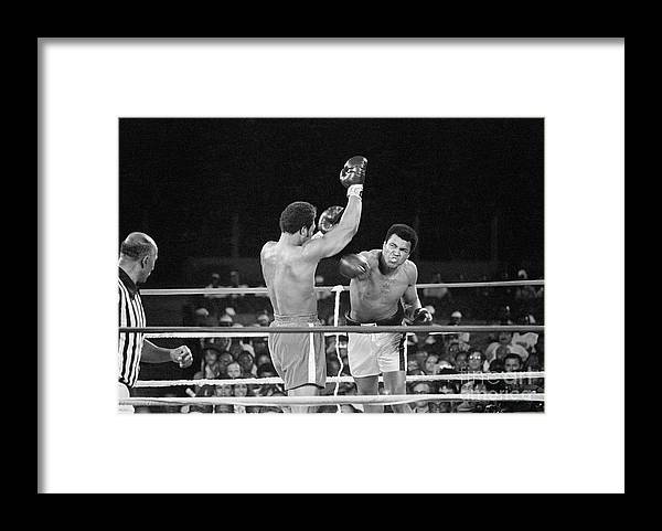 People Framed Print featuring the photograph Muhammad Ali Punching George Foreman by Bettmann