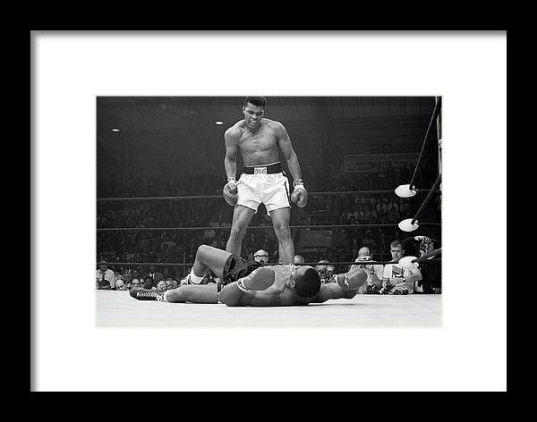 Heavyweight Framed Print featuring the photograph Muhammad Ali Taunting Sonny Liston by Bettmann