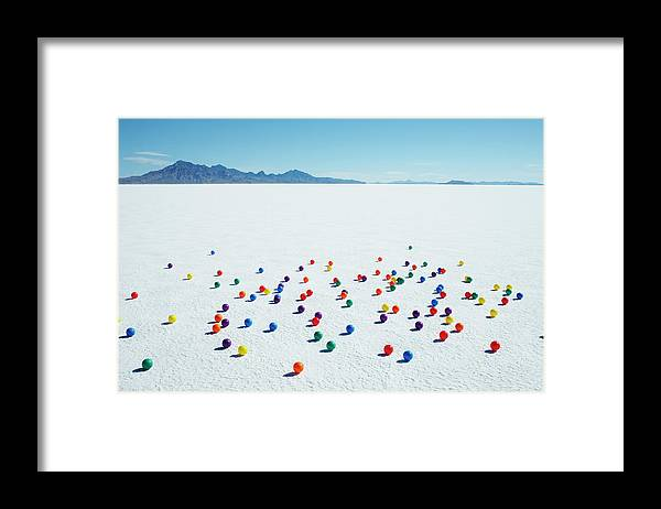 Out Of Context Framed Print featuring the photograph Multi-colored Balls On Salt Flats by Andy Ryan