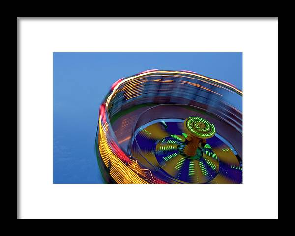Carousel Framed Print featuring the photograph Multicolored Spinning Carnival Ride by By Ken Ilio