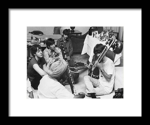 Education Framed Print featuring the photograph Musician George Harrison Receiving by Bettmann