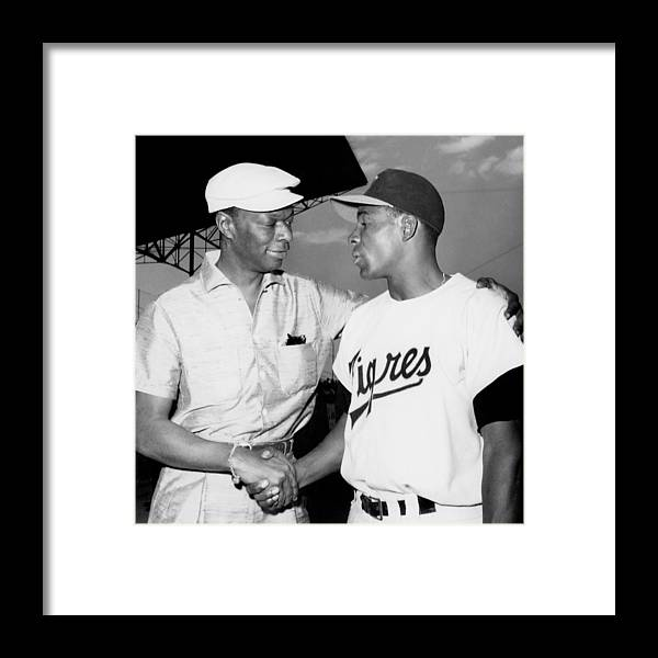1950-1959 Framed Print featuring the photograph Nat King Cole And Minnie Minoso by Michael Ochs Archives