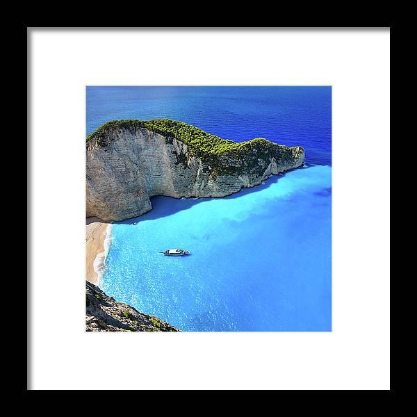Extreme Terrain Framed Print featuring the photograph Navagio Beach, Zakynthos Island, Greece by Rusm