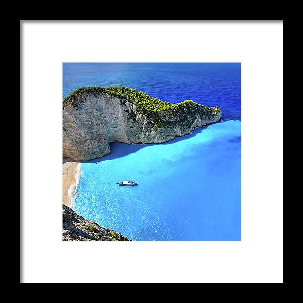Extreme Terrain Framed Print featuring the photograph Navagio Beach, Zakynthos Island, Greece by Rusm