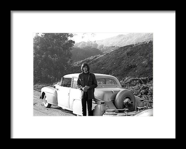 Singer Framed Print featuring the photograph Neil Young And His Classic Car by Michael Ochs Archives