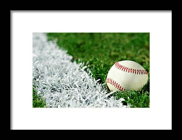 Grass Framed Print featuring the photograph New Baseball Along Foul Line by Cmannphoto
