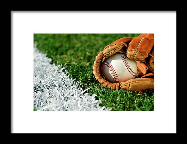 Grass Framed Print featuring the photograph New Baseball In Glove Along Foul Line by Cmannphoto