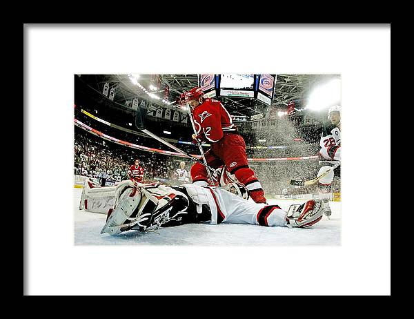 Playoffs Framed Print featuring the photograph New Jersey Devils V Carolina Hurricanes by Bruce Bennett