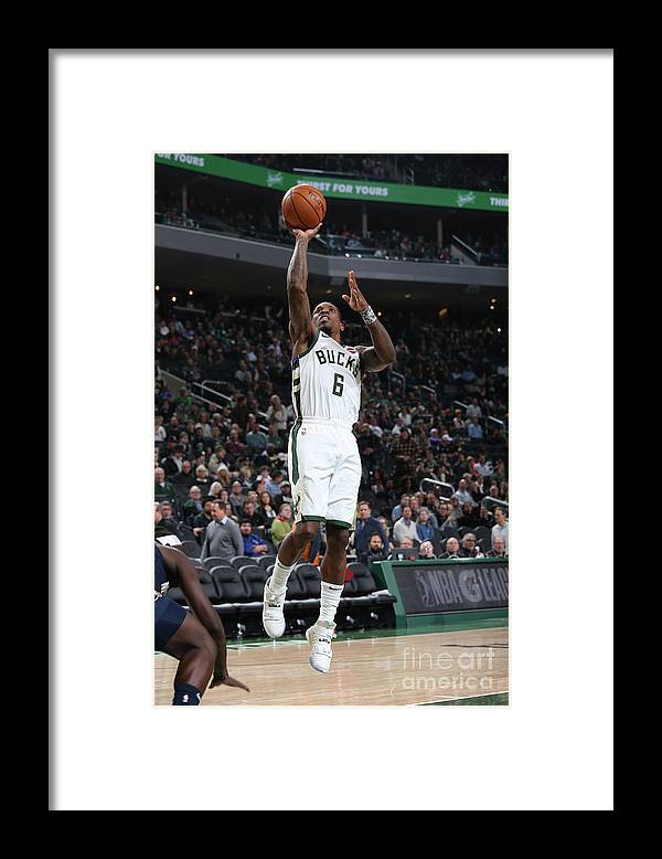 Nba Pro Basketball Framed Print featuring the photograph New Orleans Pelicans V Milwaukee Bucks by Gary Dineen