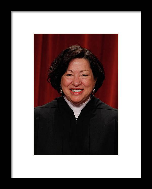People Framed Print featuring the photograph New U.s. Supreme Court Poses For Class by Chip Somodevilla