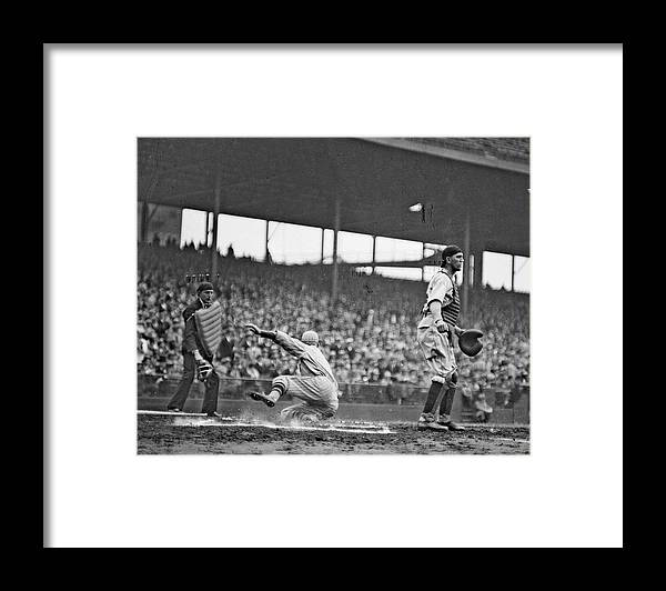 People Framed Print featuring the photograph New York Giants Baseball Player Sliding by Chicago History Museum
