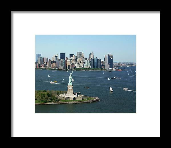 Lower Manhattan Framed Print featuring the photograph New York Harbor And Skyline by Terraxplorer