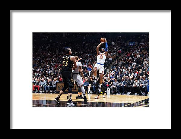 Nba Pro Basketball Framed Print featuring the photograph New York Knicks V Toronto Raptors by Mark Blinch