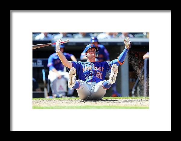 People Framed Print featuring the photograph New York Mets V New York Yankees - Game by Mike Stobe